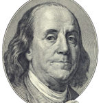 Portrait of U.S. statesman inventor and diplomat Benjamin Franklin as he looks on one hundred dollar bill obverse. Clipping path included.